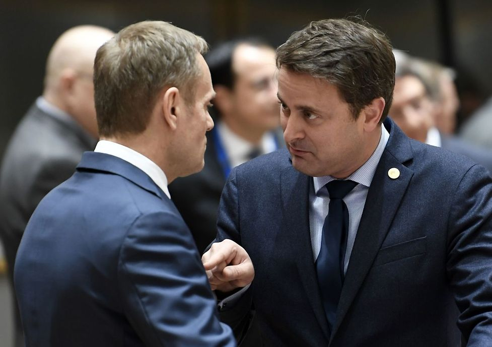 European Council President Donald Tusk talks with Luxembourg's Prime Minister Xavier Bettel