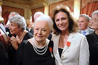 "(FILES) This file photo taken on September 09, 2010 shows English actress Jacqueline Bisset (R) next to US actress Olivia de Havilland (L) posing for a photograph on September 9, 2010 at the Elysee Palace in Paris. Screen legend Olivia de Havilland, who turns 100 on Friday, is the last surviving star from ""Gone with the Wind"" and one of the last great stars of Hollywood's bygone golden era. The two-time Oscar winner and five-time Academy Award nominee came to embody the elegant glamour of the silver screen in the 1930s and 1940s.  / AFP PHOTO / ERIC FEFERBERG"