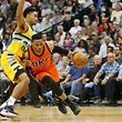Apr 9, 2017; Denver, CO, USA; Oklahoma City Thunder guard Russell Westbrook (0) drives to the basket against Denver Nuggets guard Gary Harris (14) during the second half at Pepsi Center. The Thunder won 106-105. Mandatory Credit: Chris Humphreys-USA TODAY Sports