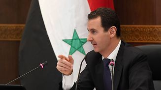 A handout picture released by the official Syrian Arab News Agency (SANA) shows Syrian President Bashar al-Assad attending a cabinet meeting during which he launched administrative reforms, on June 20, 2017, in the capital Damascus.