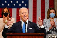 TOPSHOT - US President Joe Biden addresses a joint session of Congress as US Vice President Kamala Harris and US Speaker of the House Nancy Pelosi applaud at the US Capitol in Washington, DC, on April 28, 2021. (Photo by Melina Mara / POOL / AFP)