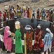 Indian women from the aboriginal 'Kol' community collect drinking water at a well in Nawargawa village, some 30km from Jabalpur, in Madhya Pradesh state on June 16, 2019. - Around 40 families in the village rely on the well for drinking water during the heatwave conditions in the remote central Indian region. (Photo by Uma Shankar MISHRA / AFP)
