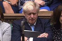 """TOPSHOT - A video grab from footage broadcast by the UK Parliament's Parliamentary Recording Unit (PRU) shows Britain's Prime Minister Boris Johnson reacting as Britain's main opposition Labour Party Jeremy Corbyn speaks in response to his speech to introduce a motion for an early parliamentary general election in the House of Commons in London on September 9, 2019, - British MPs voted Monday to demand Prime Minister Boris Johnson release confidential documents relating to Britain's EU exit, during a final day of defiance before he suspends their session until just weeks before Brexit. (Photo by - / various sources / AFP) / RESTRICTED TO EDITORIAL USE - MANDATORY CREDIT """" AFP PHOTO / PRU """" - NO USE FOR ENTERTAINMENT, SATIRICAL, MARKETING OR ADVERTISING CAMPAIGNS - EDITORS NOTE THE IMAGE HAS BEEN DIGITALLY ALTERED AT SOURCE TO OBSCURE VISIBLE DOCUMENTS"""