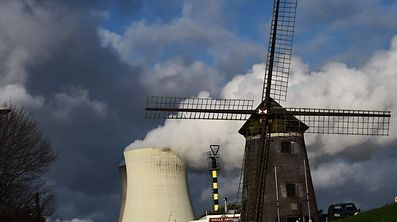 The cooling towers of Belgium's Doel nuclear plant belch thick white steam