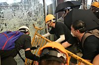 Protesters smash glass doors and windows of the government headquarters in Hong Kong on July 1, 2019 on the 22nd anniversary of the city's handover from Britain to China. - Anti-government protesters trying to ram their way into Hong Kong's parliament battled police armed with pepper spray on July 1 as the territory marked the anniversary of its handover to China. (Photo by Anthony WALLACE / AFP)