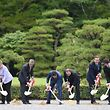 (L to R) Italian Prime Minister Matteo Renzi, German Chancellor Angela Merkel, US President Barack Obama, Japan's Prime Minister Shinzo Abe, French President Francois Hollande, Britain's Prime Minister David Cameron, Canadian Prime Minister Justin Trudeau and European Commission President Jean-Claude Juncker take part in a tree planting ceremony on the grounds at Ise-Jingu Shrine in the city of Ise in Mie prefecture, on May 26, 2016 on the first day of the G7 leaders summit. World leaders kicked off two days of G7 talks in Japan on May 26 with the creaky global economy, terrorism, refugees, China's controversial maritime claims, and a possible Brexit headlining their packed agenda. / AFP PHOTO / STEPHANE DE SAKUTIN