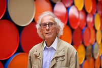 """(FILES) In this file photo taken on June 4, 2016, Bulgarian artist Christo poses in front of the monumental """"Mastaba"""" art work at the Maeght Foundation (Fondation Maeght) on the opening day of the exibition, in Saint-Paul-de-Vence, southeastern France. - Christo passed away at 84, AFP learnt on May 31, 2020. (Photo by VALERY HACHE / AFP) / RESTRICTED TO EDITORIAL USE - MANDATORY MENTION OF THE ARTIST UPON PUBLICATION - TO ILLUSTRATE THE EVENT AS SPECIFIED IN THE CAPTION"""
