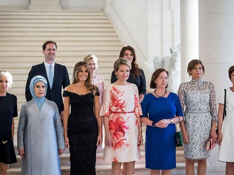 (Front row LtoR) First Lady of France Brigitte Macron, First Lady of Turkey Emine Gulbaran Erdogan, First Lady of the US Melania Trump, Queen Mathilde of Belgium, Stoltenberg's partner Ingrid Schulerud, Partner of Bulgaria's President Desislava Radeva, partner of Charles Michel Amelie Derbaudrenghien, (back row, LtoR) First Gentleman of Luxembourg Gauthier Destenay, partner of Slovenia's Prime Minister Mojca Stropnik and First Lady of Iceland Thora Margret Baldvinsdottir pose for a family photo before a diner of the First Ladies and Queen at the Royal castle in Laken/Laeken, on May 25, 2017, in Brussels. / AFP PHOTO / BELGA / Aurore Belot / Belgium OUT