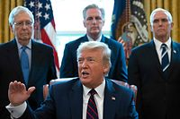 US President Donald Trump speaks before signing the CARES act, a $2 trillion rescue package to provide economic relief amid the coronavirus outbreak, at the Oval Office of the White House on March 27, 2020. - After clearing the Senate earlier this week, and as the United States became the new global epicenter of the pandemic with 92,000 confirmed cases of infection, Republicans and Democrats united to greenlight the nation's largest-ever economic relief plan. (Photo by JIM WATSON / AFP)