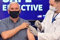 US Vice President Mike Pence receives the COVID-19 vaccine in the Eisenhower Executive Office Building in Washington, DC, December 18, 2020. (Photo by SAUL LOEB / AFP)