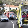 A woman receives medical assistance on April 17, 2019 in Cani�o, on the Portuguese island of Madeira, after a tourist bus crashed. - At least 28 people were killed when a tourist bus crashed on the Portuguese island of Madeira, the local mayor told local media. The regional protection service did not confirm the toll when questioned by AFP. (Photo by STRINGER / AFP)
