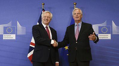 The EU's chief negotiator Michel Barnier (right) shakes hands with British Brexit Minister David Davis