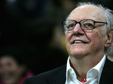 """A file photo from 2006 shows Italian playwright and 1997 Nobel literature laureate, Dario Fo, smiling as he attends a gathering with friends and students of his former art accademy """"Accademia Brera"""" in downtown Milan to celebrate his 80th birthday."""