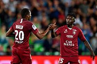 Metz's Senegalese forward Habib Diallo (L) celebrates with Metz' midfielder Adama Traore after scoring a goal during the French L1 football match between Metz (FCM) and Amiens (ASC) at Saint Symphorien stadium in Longeville-l�s-Metz, eastern France, on September 21, 2019. (Photo by JEAN-CHRISTOPHE VERHAEGEN / AFP)