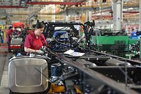 An employee works on a truck assembly line at a factory in Fuyang in China's eastern Anhui province on July 16, 2020. - China's economy returned to growth in the second quarter, rebounding more strongly than expected from a historic contraction caused by the coronavirus outbreak, official data showed on July 16. (Photo by STR / AFP) / China OUT
