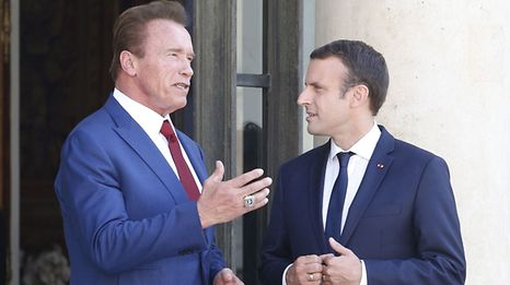 French President Emmanuel Macron meets US actor and founder of the R20 climate action group Arnold Schwarzenegger