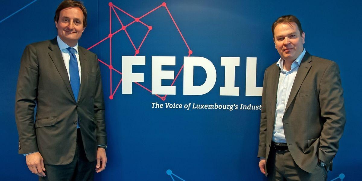 Nicolas Buck (à g.), président de la Fedil, et René Winkin (à dr.), directeur, ont présenté le nouveau visuel de la Fedil.