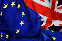 (FILES) In this file photo taken on March 14, 2019 EU and Union Flags fly outside the Houses of Parliament in London on March 14, 2019 as members debate a motion on whether to seek a delay to Britain's exit from the EU. - The European Union and Britain could agree the terms of a post-Brexit trade deal within hours, European sources told AFP on December 23, 2020, as negotiations continued. (Photo by BEN STANSALL / AFP)
