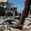 People walk on a street filled with rubble after Hurricane Matthew passes in Jeremie, Haiti, October 8, 2016. REUTERS/Carlos Garcia Rawlins