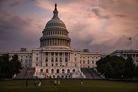 WASHINGTON, DC - JULY 26: The U.S. Capitol Building is seen as the sun sets and a heavy thunderstorm blew through the area on Capitol Hill on July 26, 2021 in Washington, DC. Negotiations over the Infrastructure Bill continue in Congress as the rush to get it passed before their August recess after the initial agreement fell apart.   Samuel Corum/Getty Images/AFP == FOR NEWSPAPERS, INTERNET, TELCOS & TELEVISION USE ONLY ==