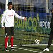 Portugal's head coach Fernando Santos (R) speaks with his player Cristiano Ronaldo (L) during the team's training session in preparation for the upcoming Euro 2016 soccer qualifying soccer match against the Serbian to be held next 29 March, in Estoril outskirts of Lisbon, Portugal, 28 March 2015. IN�CIO ROSA/LUSA
