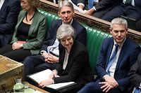 "A handout photograph released by the UK Parliament shows Britain's Prime Minister Theresa May (C) smiling in the House of Commons in London on January 29, 2019, as members of Parliament vote on amendments to Theresa May's Brexit withdrawal bill. - British MPs on Tuesday voted on a series of amendments seeking to show what they want as Brexit approaches on March 29, with Britain currently on course to crash out of the EU without a withdrawal deal. (Photo by Jessica TAYLOR / UK PARLIAMENT / AFP) / RESTRICTED TO EDITORIAL USE - NO USE FOR ENTERTAINMENT, SATIRICAL, ADVERTISING PURPOSES - MANDATORY CREDIT "" AFP PHOTO /JESSICA TAYLOR / UK Parliament"""