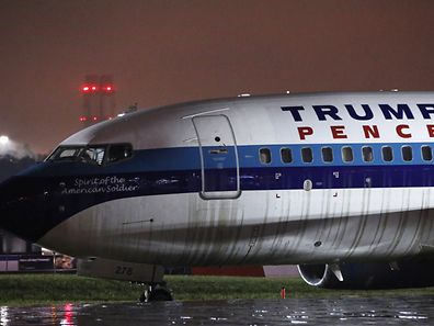 A campaign plane that had been carrying U.S. Republican vice presidential candidate Mike Pence rests in the grass after it skidded off the runway while landing in the rain at LaGuardia Airport in New York, U.S.,October 27, 2016