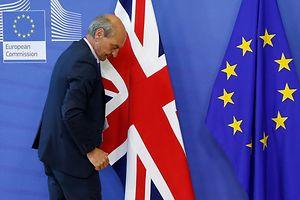 A worker arranges flags at the EU headquarters as Britain and the EU launch Brexit talks in Brussels, June 19, 2017.    REUTERS/Francois Lenoir