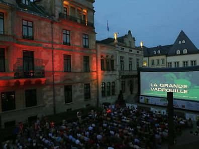 "2013 photo of the outdoor cinema screen in front of the Grand Ducal Palace. This year, viewers can see films including ""Grease"", ""The Pink Panther"" and ""Goldfinger"""
