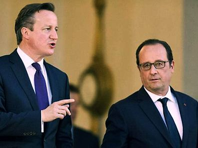 Britain's Prime Minister David Cameron leaves with French President Francois Hollande, after their meeting, at the Elysee Palace in Paris, Thursday May 28, 2015