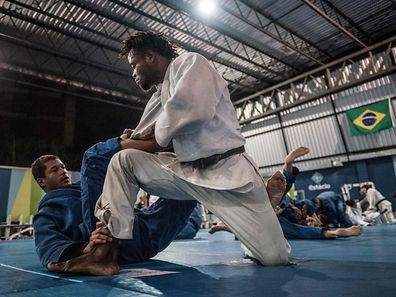 Popole Misenga, 24 (R), a refugee judoka from the Democratic Republic of Congo, during a training at Instituto Reacao in Rio de Janeiro, Brazil