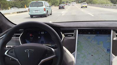 The interior of a Tesla Model S is shown in autopilot mode in San Francisco, California, U.S., April 7, 2016.   REUTERS/Alexandria Sage/File Photo