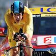 (FILES) This file photo taken on July 09, 2012 shows Stage winner, Overall leader's yellow jersey, British Bradley Wiggins, competing at the end of the 41,5 km individual time-trial and ninth stage of the 2012 Tour de France cycling race starting in Arc-et-Senans and finishing in Besancon, eastern France, on July 9, 2012.   Bradley Wiggins announced his retirement from professional cycling on December 28, 2016, bringing the curtain down on a career that saw him become one of Britain's greatest sportsmen. The 36-year-old became Britain's first Tour de France winner in 2012 and bows out with eight Olympic medals, including five golds, and seven world titles, across track and road cycling, to his name.  / AFP PHOTO / PASCAL PAVANI