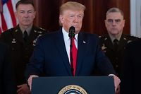 """US President Donald Trump speaks about the situation with Iran in the Grand Foyer of the White House in Washington, DC, January 8, 2020. - US President Donald Trump said Wednesday Iran appeared to be """"standing down"""" after missile strikes on US troop bases in Iraq that resulted in no American or Iraqi deaths. """"All of our soldiers are safe and only minimal damage was sustained at our military bases. Our great American forces are prepared for anything,"""" he said in an address to the nation from the White House. (Photo by SAUL LOEB / AFP)"""