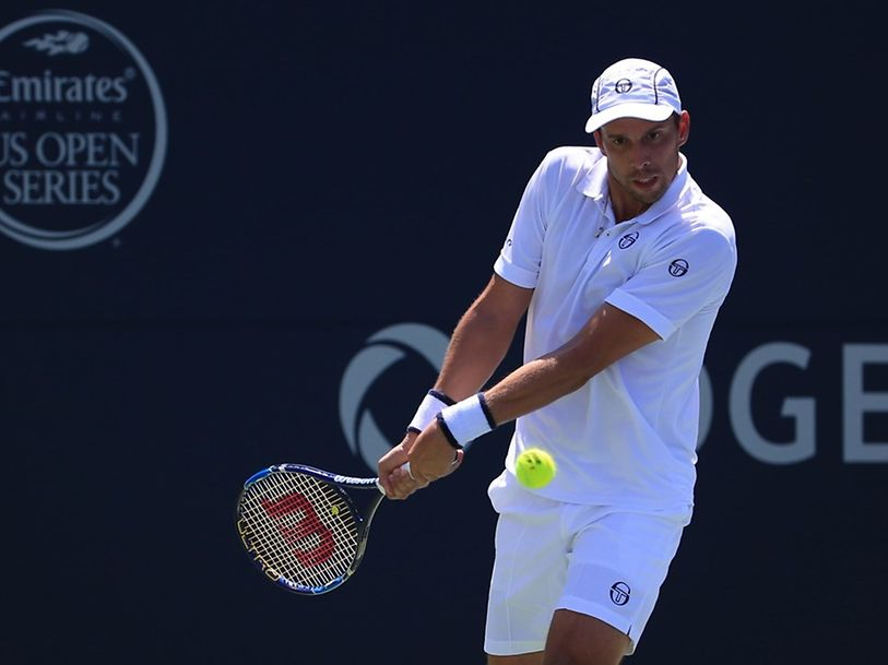 TORONTO, ON - JULY 27: Gilles Muller of Luxembourg plays a shot against Novak Djokovic of Serbia on Day 3 of the Rogers Cup at the Aviva Centre on July 27, 2016 in Toronto, Ontario, Canada.   Vaughn Ridley/Getty Images/AFP == FOR NEWSPAPERS, INTERNET, TELCOS & TELEVISION USE ONLY ==