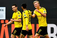 Dortmund's Portuguese defender Raphael Guerreiro (L) celebrates with Dortmund's German midfielder Mahmoud Dahoud (C) and Dortmund's Norwegian forward Erling Braut Haaland after scoring his side's second goal during the German first division Bundesliga football match BVB Borussia Dortmund v Schalke 04 on May 16, 2020 in Dortmund, western Germany as the season resumed following a two-month absence due to the novel coronavirus COVID-19 pandemic. (Photo by Martin Meissner / POOL / AFP) / DFL REGULATIONS PROHIBIT ANY USE OF PHOTOGRAPHS AS IMAGE SEQUENCES AND/OR QUASI-VIDEO