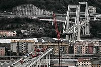TOPSHOT - A general view shows technicians set up material and work on the western section of the remains of the Morandi bridge (Bottom L) in Genoa, on February 7, 2019, on the eve of the official start of the demolition work of the first meters of the western section of the bridge. (Photo by Marco BERTORELLO / AFP)