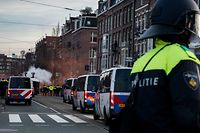 At the Museumplein in Amsterdam a demonstration is held against restrictions put in place to curb the spread of the Covid-19 virus on 31 January 2021. Since the curfew was implemeted, tensions have increased and riots have erupted in several Dutch cities.