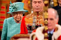 TOPSHOT - Britain's Queen Elizabeth II walks behind the Imperial State Crown as they proccess through the Royal Gallery, before the Queen's Speech, during the State Opening of Parliament at the Houses of Parliament in London on December 19, 2019. - The State Opening of Parliament is where Queen Elizabeth II performs her ceremonial duty of informing parliament about the government's agenda for the coming year in a Queen's Speech. (Photo by Matt Dunham / POOL / AFP)