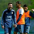 Argentina's forwards Lionel Messi (L) laughs next to defenders Gabriel Mercado (C) and Milton Casco during a training session in Ezeiza, Buenos Aires on October 8, 2017 ahead of a 2018 FIFA World Cup South American qualifier football match against Ecuador to be held in Quito on October 10.  / AFP PHOTO / ALEJANDRO PAGNI