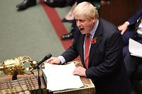 """A handout picture released by the UK Parliament shows shows Britain's Prime Minister Boris Johnson speaking in the House of Commons in London on October 29, 2019, during a debate on the Early Parliamentary General Election Bill: Second Reading. - Britain was on course for a December election Tuesday after the main opposition Labour party said it would support Prime Minister Boris Johnson's plan, although a date has not yet been fixed. Labour leader Jeremy Corbyn said: """"I have consistently said that we are ready for an election and our support is subject to a 'no deal' Brexit being off the table."""" (Photo by JESSICA TAYLOR / various sources / AFP) / RESTRICTED TO EDITORIAL USE - MANDATORY CREDIT """" AFP PHOTO / UK PARLIAMENT / Jessica Taylor """" - NO USE FOR ENTERTAINMENT, SATIRICAL, MARKETING OR ADVERTISING CAMPAIGNS - EDITORS NOTE THE IMAGE HAS BEEN DIGITALLY ALTERED AT SOURCE TO OBSCURE VISIBLE DOCUMENTS /"""