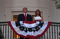 "US President Donald Trump and First Lady Melania Trump stand in the Truman Balcony as they host the 2020 ""Salute to America"" event in honor of Independence Day on the South Lawn of the White House in Washington, DC, July 4, 2020. (Photo by SAUL LOEB / AFP)"