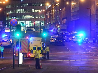 Emergency response vehicles are parked at the scene of a suspected terrorist attack during a pop concert by US star Ariana Grande in Manchester, northwest England on May 23, 2017. / AFP PHOTO / Paul ELLIS