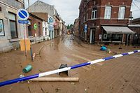 This picture taken in Namur on July 25, 2021 shows the mud covering a street after the heavy rainfall of July 24. - In mid-July western Europe was hit by devastating floods after torrential rains that ravaged entire villages and left at least 209 people dead in Germany and Belgium, as well as dozens missing. The flooding also caused damage in Luxembourg, the Netherlands and Switzerland. (Photo by NICOLAS MAETERLINCK / BELGA / AFP) / Belgium OUT