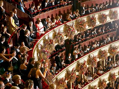 People arrive for the traditional Opera Ball in Vienna, Austria, February 23, 2017. REUTERS/Leonhard Foeger