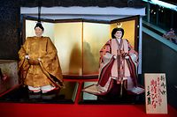 Dolls representing the next Japanese emperor Naruhito (L) and his wife Masako are displayed at Kyugetsu store in Tokyo on February 22, 2019. (Photo by Martin BUREAU / AFP)