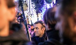 French President Emmanuel Macron meets people as he visit the Christmas market in Strasbourg on December 14, 2018 as he came to pay tribute to the victims of the December 11 attack who killed four people. - The alleged gunman who had been on the run since allegedly killing four people at Strasbourg's popular Christmas market has been shot dead by police on December 13 in the Neudorf neighbourhood of Strasbourg. (Photo by Jean-Francois Badias / AFP)