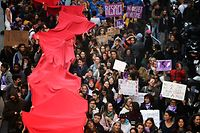 People hold a red banner during a march on the eve of the International Day for the Elimination of Violence against Women on November 24, 2018 in Marseille, southeastern France. (Photo by BORIS HORVAT / AFP)