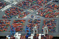 File photo of a container ship being loaded at a terminal in the harbour of Hamburg, late September 23, 2012. German exports rose unexpectedly in August, underscoring the continued resilience of Europe's largest and traditionally export-oriented economy despite the euro zone crisis and suggesting a third quarter slowdown may be moderate. Official data released October 8, 2012, showed seasonally adjusted exports jumped 2.4 percent month-on-month, far outperforming expectations for a drop of 0.5 percent and beating even the highest forecast in a Reuters poll of 17 economists for a 0.5 percent rise. Picture taken September 23. REUTERS/Fabian Bimmer/Files  (GERMANY - Tags: BUSINESS)