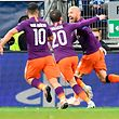 Manchester City's Spanish midfielder David Silva (R) celebrates scoring the 1-2 goal with his team-mates goal during the UEFA Champions League group F football match between TSG 1899 Hoffenheim and Manchester City at the Rhein-Neckar-Arena in Sinsheim, southwestern Germany, on October 2, 2018. (Photo by THOMAS KIENZLE / AFP)